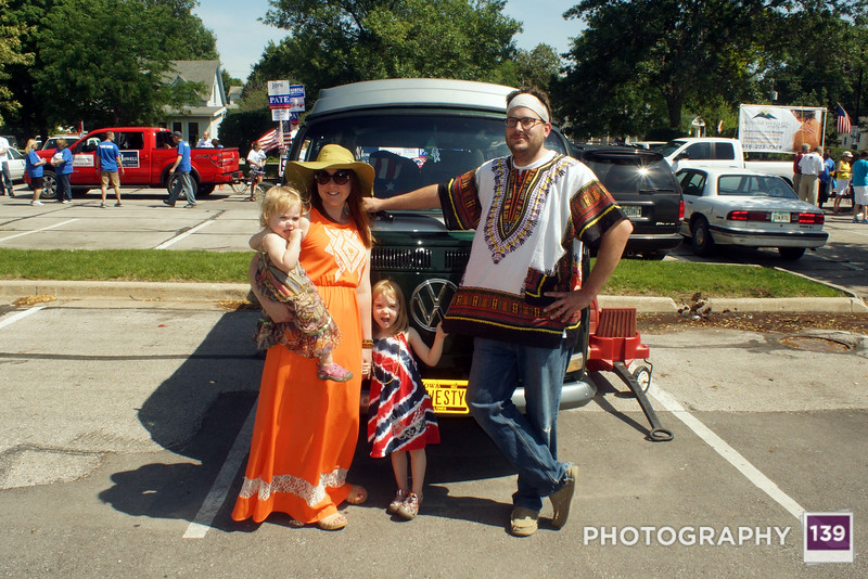 Layla, Jen, Evie, & Derrick preparing to represent Rieman's Music in the 2014 Ames Fourth of July Parade.