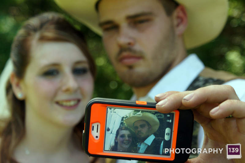 Debra and Brandon taking a selfie after their wedding.
