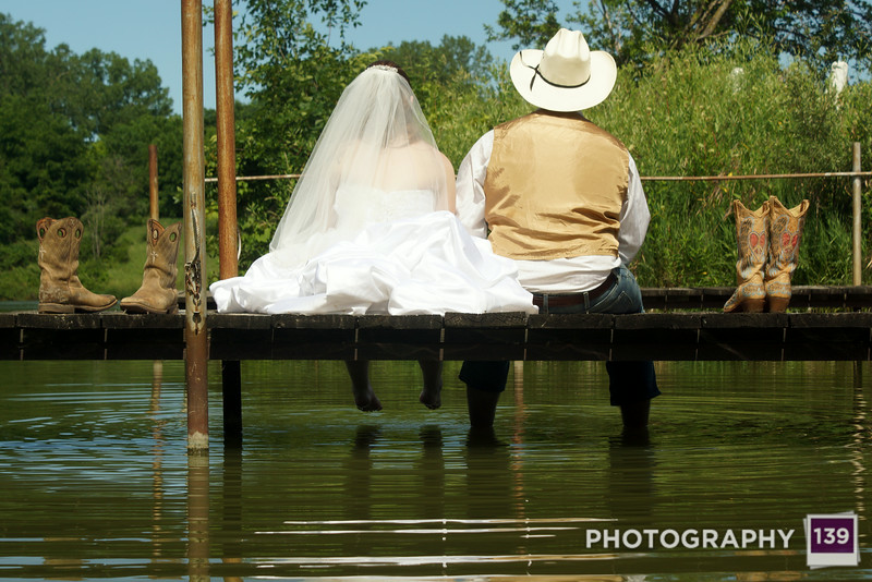 Debra and Brandon taking it easy on the dock after the wedding.