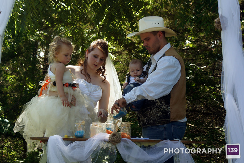 Brandon, Debra, and helpers filling the sand jars during their wedding.
