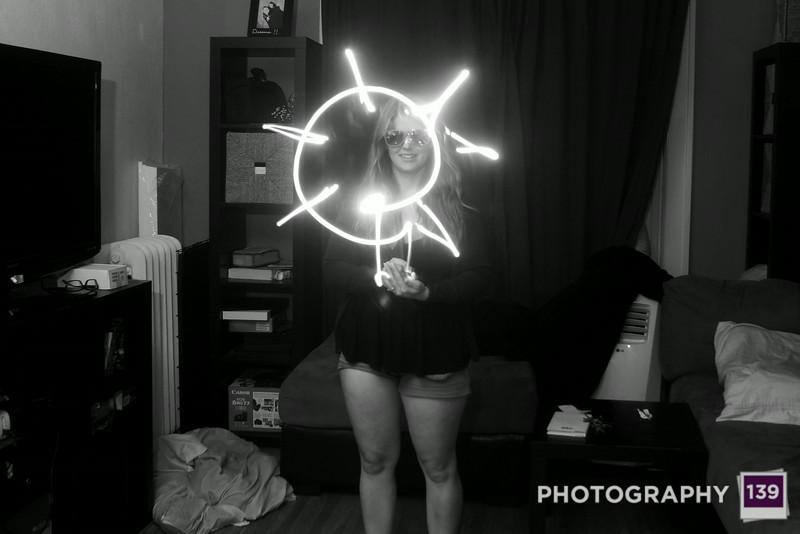 Bethany light painting a sun.