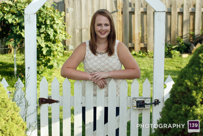 Kalista senior picture in my backyard by my cute white fence.