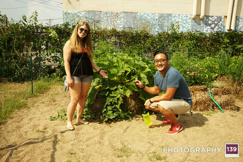 Minnesota Gothic. Bethany and DaeHee showing off their urban garden.