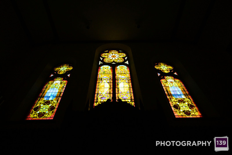 The stained glass windows behind the altar at the First United Methodist Church in Boone.